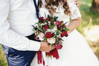 Bride and groom is holding wedding bouquet