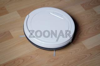 robotic or robot vacuum cleaner on laminate floor