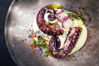 Traditional Italian polpo alla griglia su crema di patate with barbecued octopus