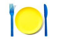 Colorful Empty Plate, fork and knife isolated on white background