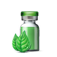 Transparent glass ampule with vaccine or drug for medical treatment and two green leaves.