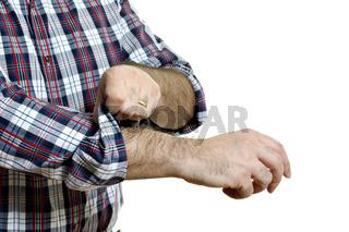 Man rolls up sleeves