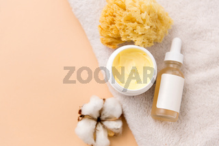 body butter, essential oil, sponge on bath towel