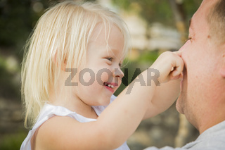 Father Playing With Cute Baby Girl Outside at the Park