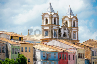 Colorful historic district of Pelourinho with cathedral on the background.