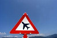 airplane symbol on traffic sign