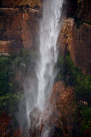 Powerful waterfall tumbling over sandstone cliffs