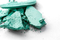 Mint eye shadow powder as makeup palette closeup isolated on white background, crushed cosmetics and beauty texture