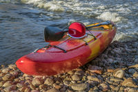 whitewater kayak with helmet