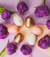 Easter eggs with tulips on a colorful geometric background