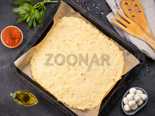 homemade cauliflower pizza crust dough with ingredients