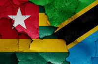 flags of Togo and Tanzania painted on cracked wall