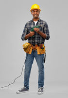 happy indian builder in helmet with electric drill