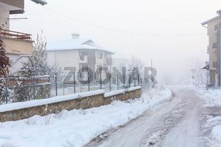 Street view and mountains peak in Bansko, Bulgaria