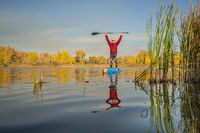 senior stand up paddler on a lake
