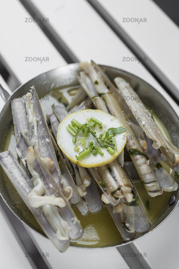 razor clams sauteed with garlic butter white wine in spain