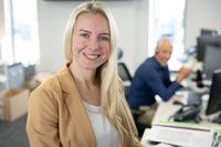 Portrait of businesswoman smiling at modern office