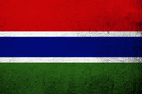 The Republic of The Gambia National flag. Grunge background