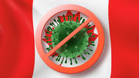 Warning sign with crossed out Coronavirus bacteria on the background of Canadian flag.