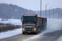 Red Volvo FH16 Trucking on Snowy Day