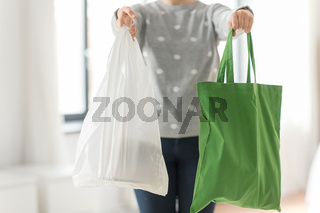 woman with tote for shopping and plastic bag