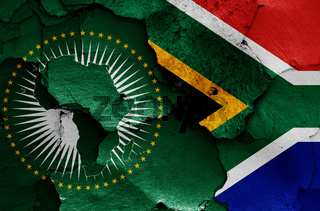 flags of African Union and South Africa painted on cracked wall