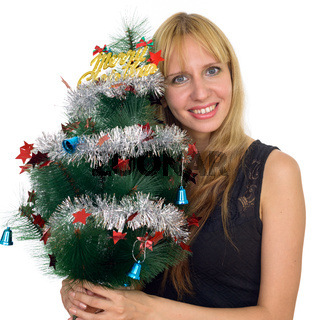 Portrait of happy blonde businesswoman holding Christmas tree ready for Christmas