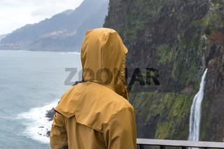 Woman looking at Bridal Veil Falls veu da noiva in Madeira, Portugal