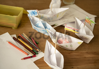 Paper ships made and painted by children