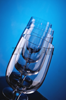 Group of wine glasses on colour a gradient a background
