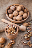 Walnuts in wooden bowls on wooden table
