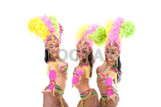 Trio of artistic samba dancers smiling at camera