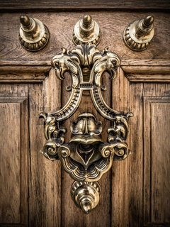 A Decorative Brass Door Knocker