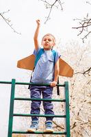 Active little boy on a climbing frame, dreaming of becaming a spaceman