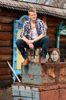 The beautiful man against wooden house