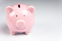 Pink piggy bank on white background