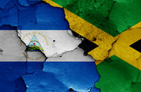 flags of Nicaragua and Jamaica painted on cracked wall