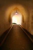 alley with light in castle in Lisbon, Portugal