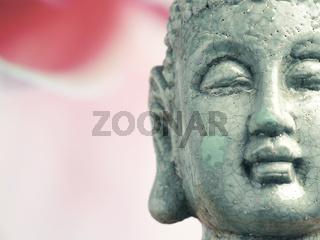 Statue of Buddha on a blurry background