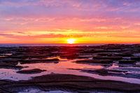 Pretty sunrise over the ocean and beach