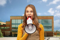 teenage girl speaking to megaphone over school