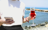 Woman with glass of pink wine enjoying summer