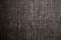 Decorative dark linen fabric textured background for interior, furniture design and art canvas backdrop