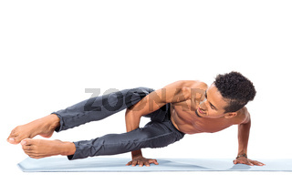 Young man doing yoga asana poses exercise studio photo isolated on white background