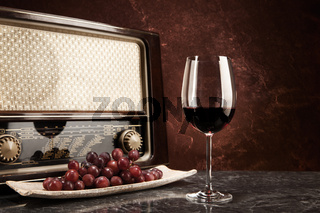 A glass of red wine with music from the radio