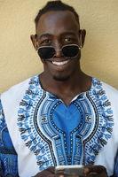 native african black man using smart phone
