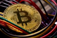 Bitcoin coin, colorful cables and printed circuit board PCB