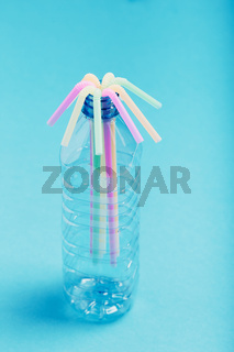 Plastic bottle with colorful straws