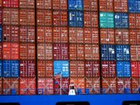 Large container cargo ship at the port in Rotterdam