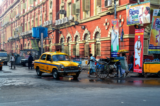 Yellow cabs and hand-pulled rickshaws are very commonly used in Calcutta.